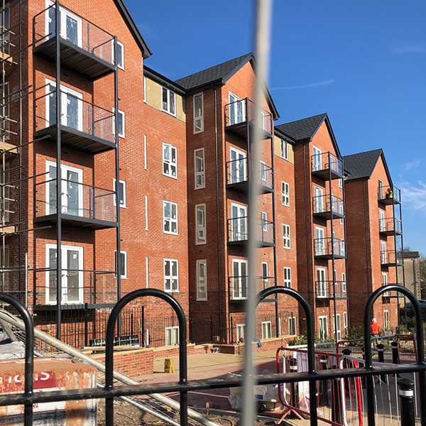 Target Windows installing acoustic glass windows at retirement apartments