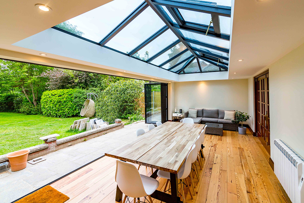 Open dining room with bi fold doors into the garden